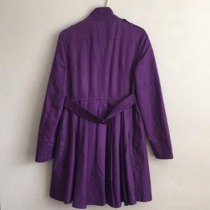 Feminine coat, sturdy top, waterfall below waist